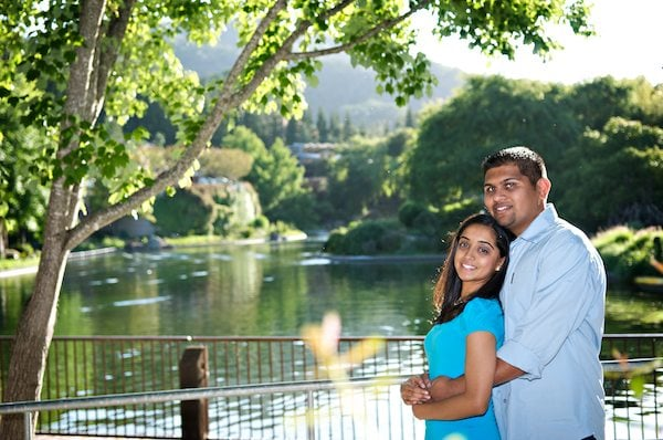 Engagement Portrait of Indian Couple in front of a lake at Gilroy Gardens