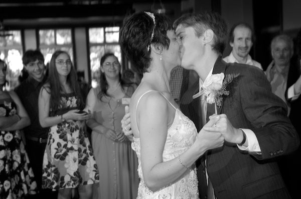 Brides kiss during first dance - Bancroft Hotel Wedding Reception - Bancroft Hotel Berkeley