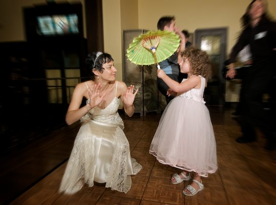 Bride bends down to connect with flower girl - Bancroft Hotel Wedding Reception - Bancroft Hotel Berkeley
