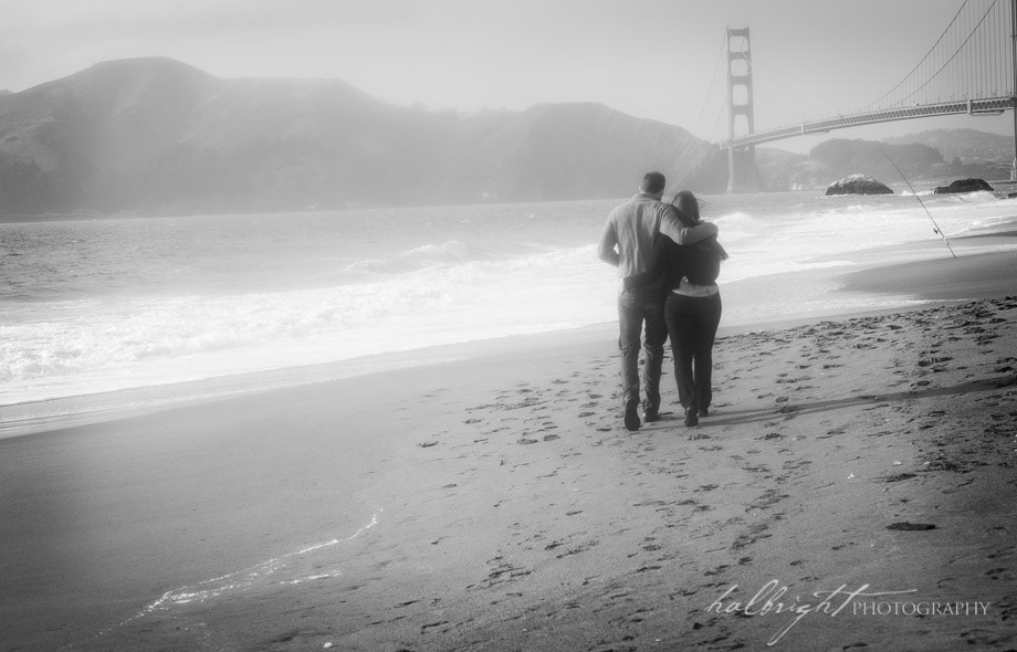 Couple walks towards the Golden Gate Bridge in San Francisco's Baker Beach | Engagement Portrait - Baker Beach - San Francisco Engagement Photographer