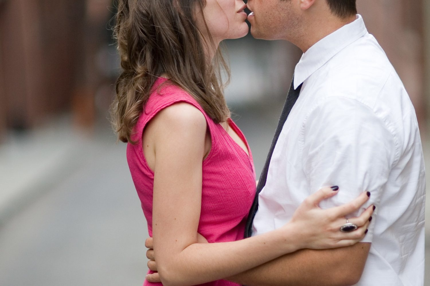 Couple kissing during engagement portrait in San Francisco
