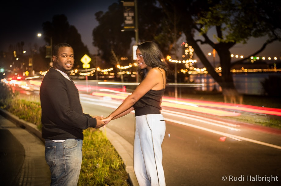 Engagement portrait - Lake Merritt - Oakland, California - trailing lights from cars