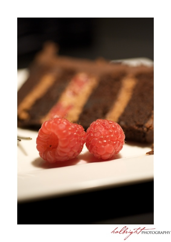 Chocolate Wedding Cake slice with two raspberries | San Francisco LGBT Wedding - San Francisco Wedding