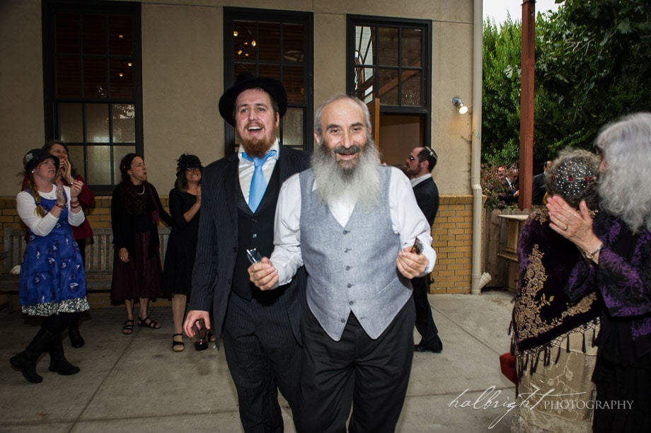 The Groom Arrives at the Kabbat Panim to see his Bride for the First Time in a Week at an Orthodox Jewish Wedding in Berkeley