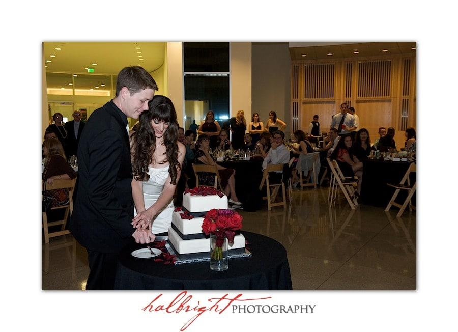 Alicia and Thomas cutting their wedding cake | San Jose City Hall Rotunda - Rotunda Wedding - Wedding Photography