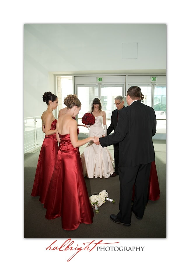 The bride, bridesmaids and minister gather to pray before the wedding | San Jose City Hall Wedding - San Jose Rotunda - Rotunda Wedding