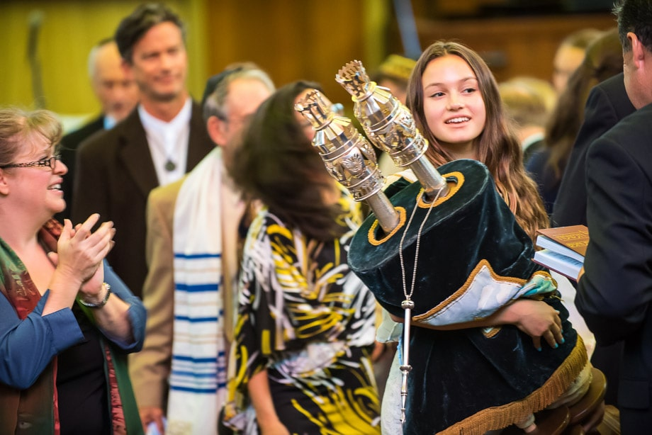 Zoe, the Bat Mitzvah, carries the torah around the synagogue at Or Shalom in San Francisco, CA