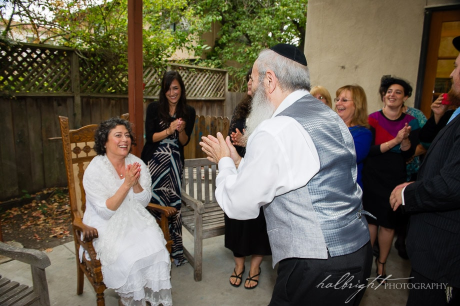 Bride and Groom greet each other at their Orthodox Jewish Wedding at Congregation Beth Isreal in Berkeley California right before the Bedken