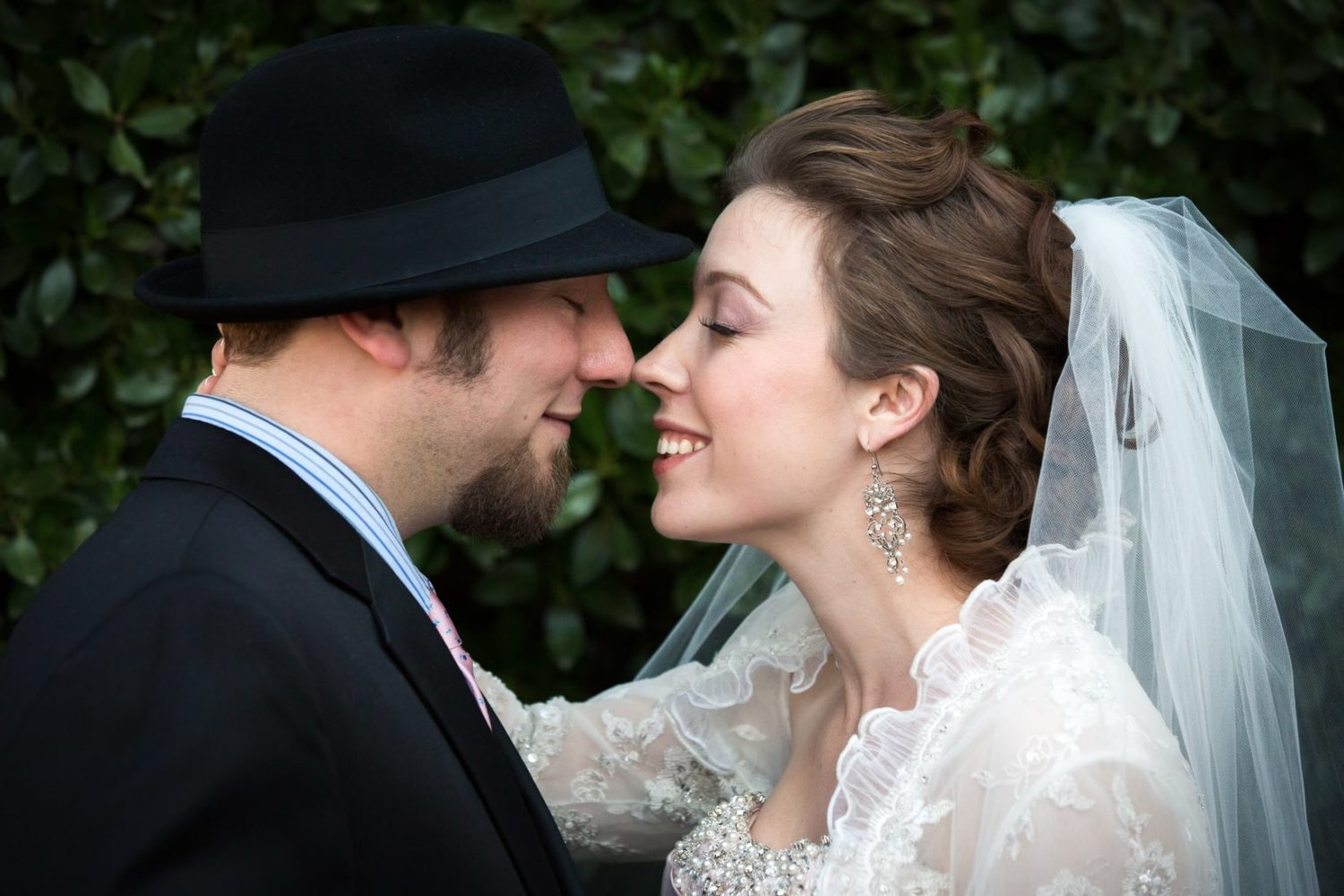 Bride and Groom touch noses lovingly on their wedding day - Congregation Beth Israel - Berkeley Wedding