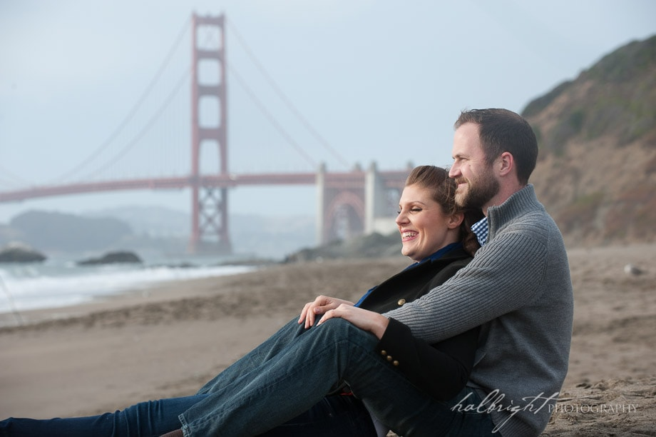 Couple photographed in front of Golden Gate Bridge in San Francisco's Baker Beach | Engagement Portrait - Baker Beach - San Francisco Engagement Photographer