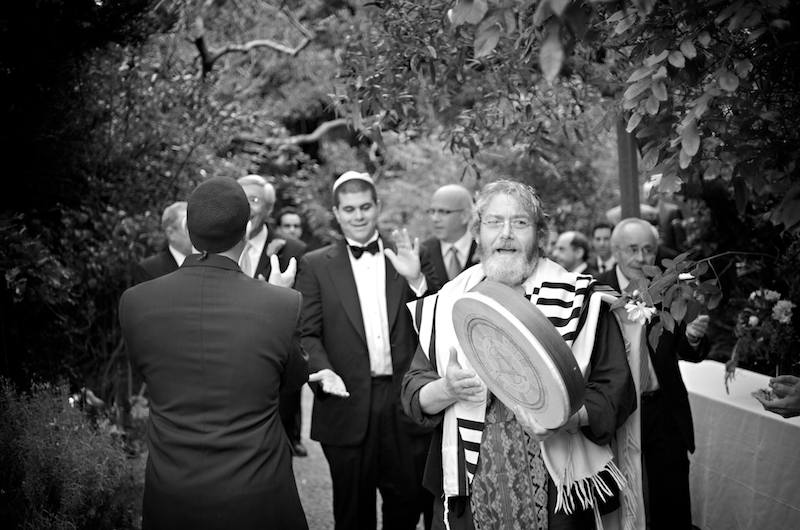 Avram Davis leads Josh and his entourage on their march to join the women - Jewish Wedding - Bodega Bay