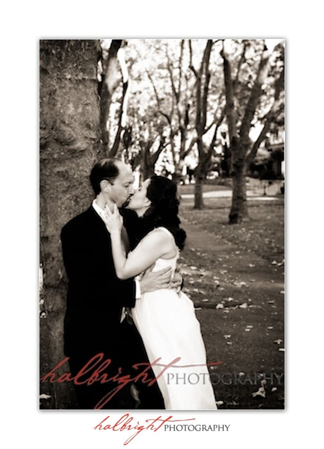Mills College Wedding - Bride and groom kissing while leaned against redwood tree - oakland wedding photographer