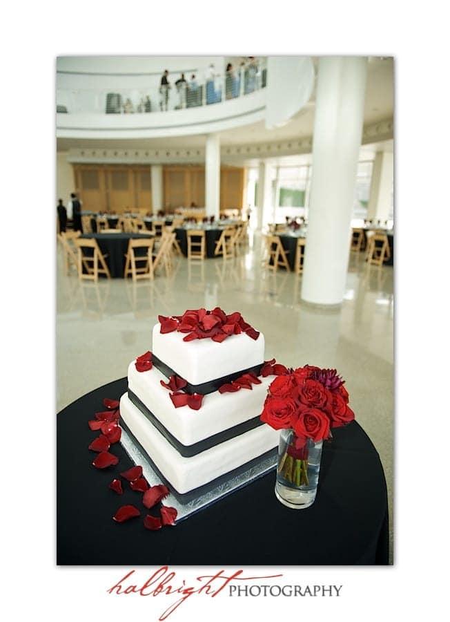 The Wedding Cake with the bride's bouquet | San Jose City Hall - San Jose Rotunda Wedding