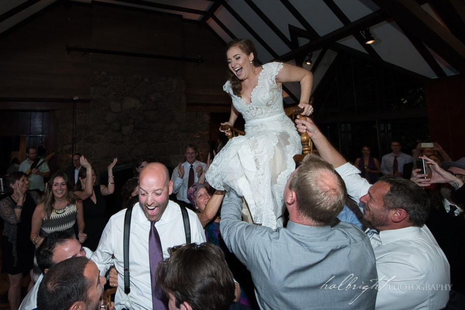 The Bride is lifted up on a chair during the Hora at her wedding in the Brazil Room in Berkeley