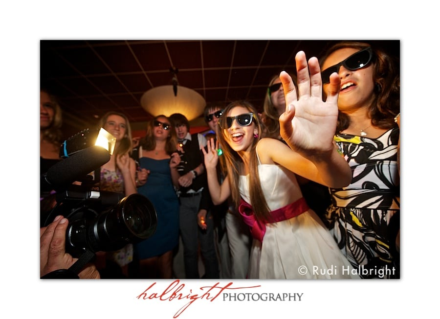 Bat Mitzvah Girl, smiles on the dance floor at her bat mitzvah reception
