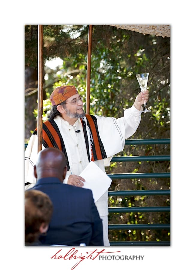 Rabbi David Cooper of Kehillah Community Congregation says a blessing over the wine - Wedding Ceremony - Joaquin Miller Park and Community Center