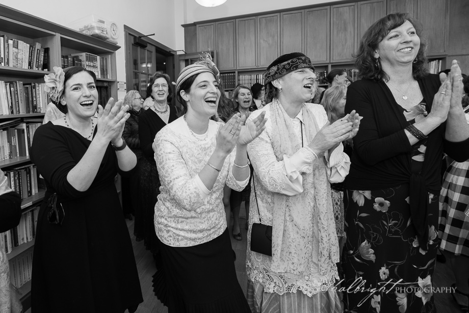 Friends of the bride applaud as the bedeken is about to begin.