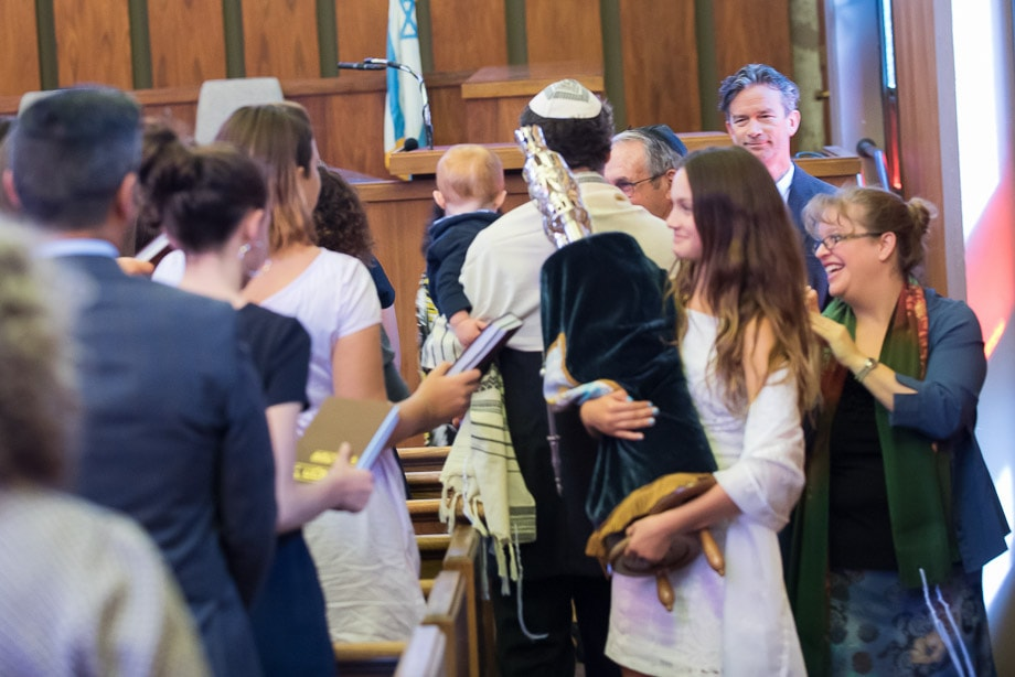 Zoe Waxman carries the torah during the torah service in her Bat Mitzvah at Temple Or Shalom, San Francisco