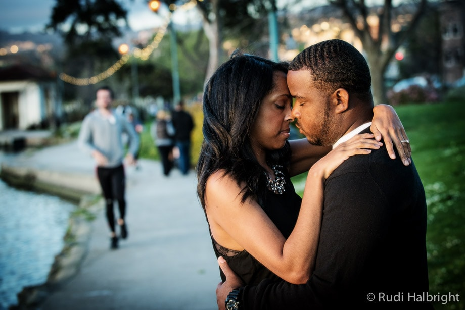 Couple is photographed for their Engagement Portrait near Lake Merritt in Oakland, California   Oakland Portrait Photographer