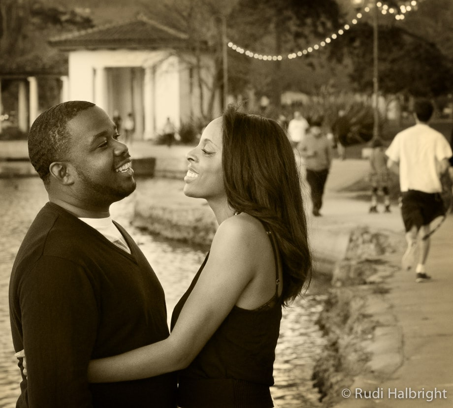 Black couple smiling and facing each other in Lake Merritt in Oakland California portrayed in Sepia tone | Oakland Engagement Portrait - Lake Merritt
