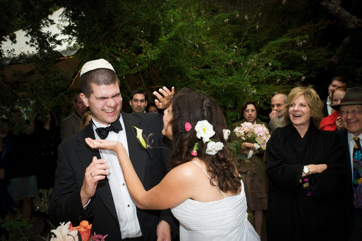 Bride smushes groom with cake