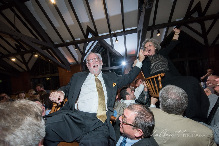 The Parents of the Groom are lifted up on their chairs for the Hora at Jewish Wedding