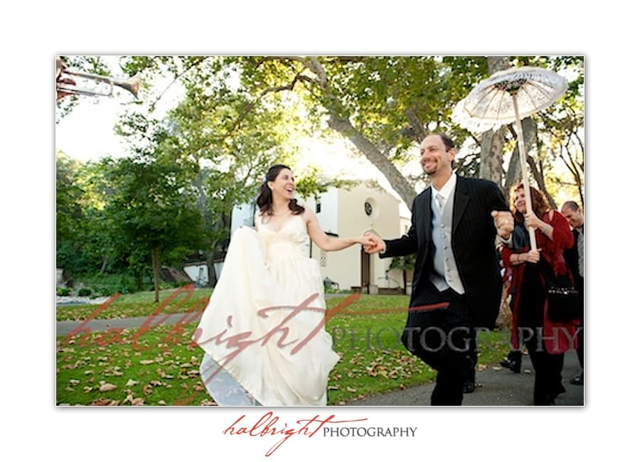 Bride and groom leading parade of guests on Mills College Campus - Oakland Wedding