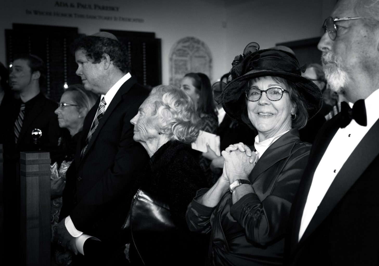Black and White photo of guest with clasped hands | Wedding at Congregation Beth Israel Berkeley