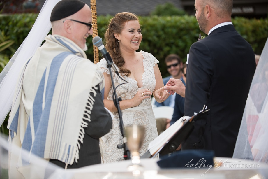 Brazil Room Wedding - Bride smiles as groom puts ring on her hand - Tilden Park Wedding - Berkeley Wedding Photography