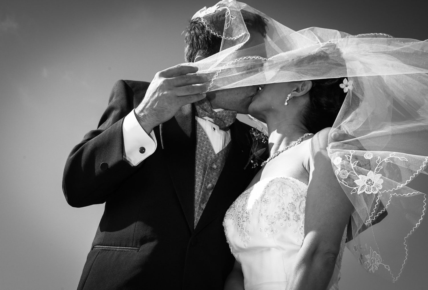 Bride and Groom Kiss Behind Veil on a windy day in San Francisco