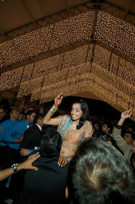 Bride is raised up by friends and family - Indian Wedding - Gilroy Gardens Wedding