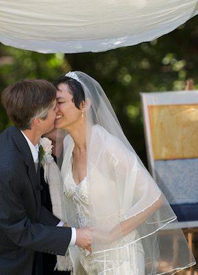 Brides kiss under Chuppah - UC Berkeley Faculty Club - Wedding