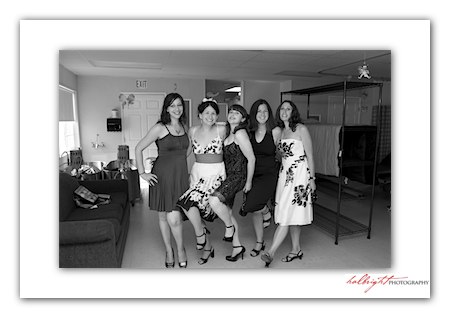 Five bridesmaids standing together posing for a portrait at their friend's wedding - Camp Arroyo