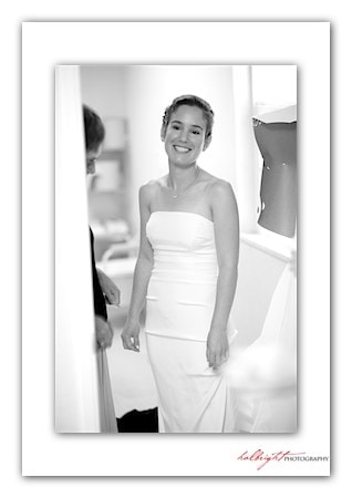 Bride in white standing in front of mirror - Camp Arroyo Wedding - Livermore Wedding