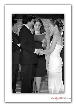 Groom puts ring on his bride - Camp Arroyo Wedding